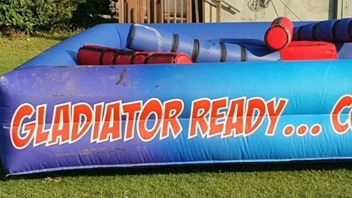 inflatable gladiator hire london